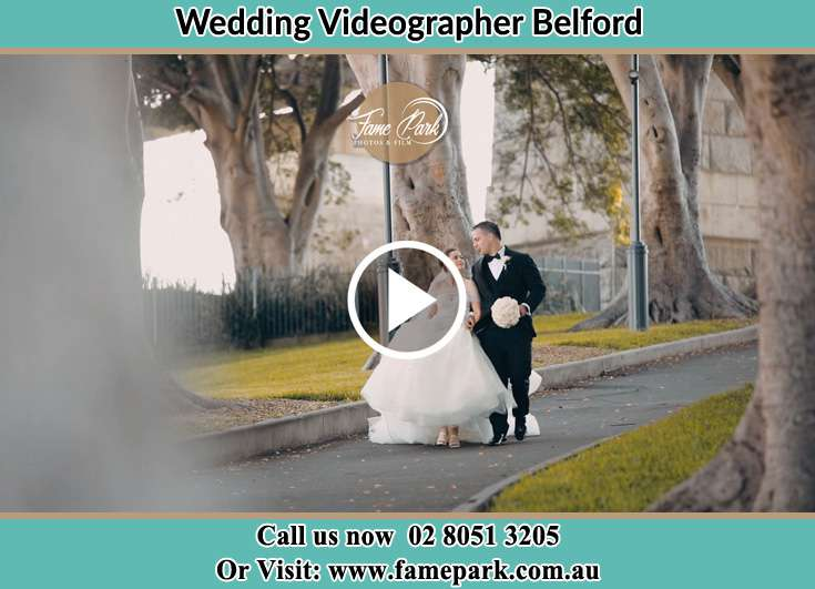 Bride and Groom looking at each other while walking in the park Belford NSW 2335