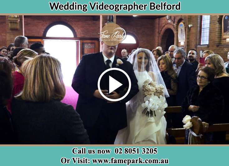 The Bride walking down the aisle with her father Belford NSW 2335