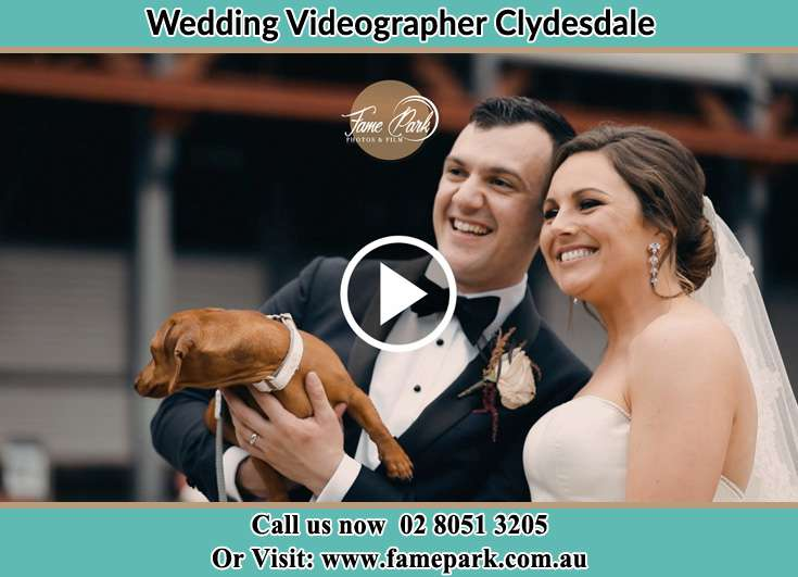 The Groom and the Bride smiles for the camera with their dog Clydesdale NSW 2330