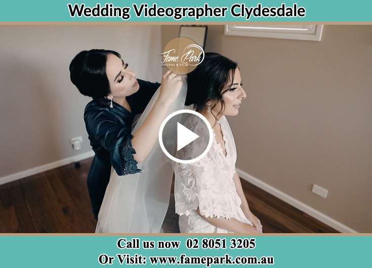 A young woman helping the Bride to get ready for the wedding Clydesdale NSW 2330
