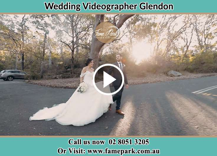 The Groom and the Bride walking in the car park Glendon NSW 2330