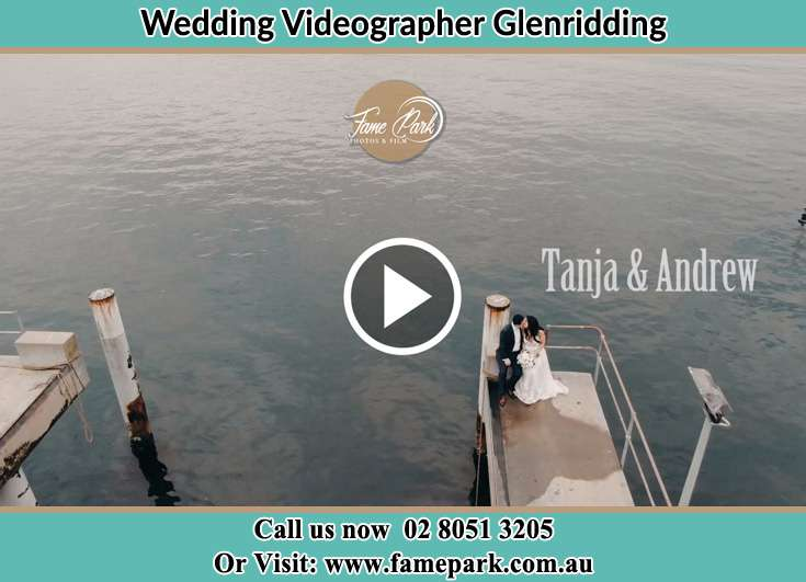 The newlyweds kissing near the shore Glenridding NSW 2330