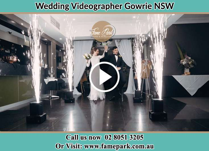The newlyweds entering the reception venue Gowrie NSW NSW 2060