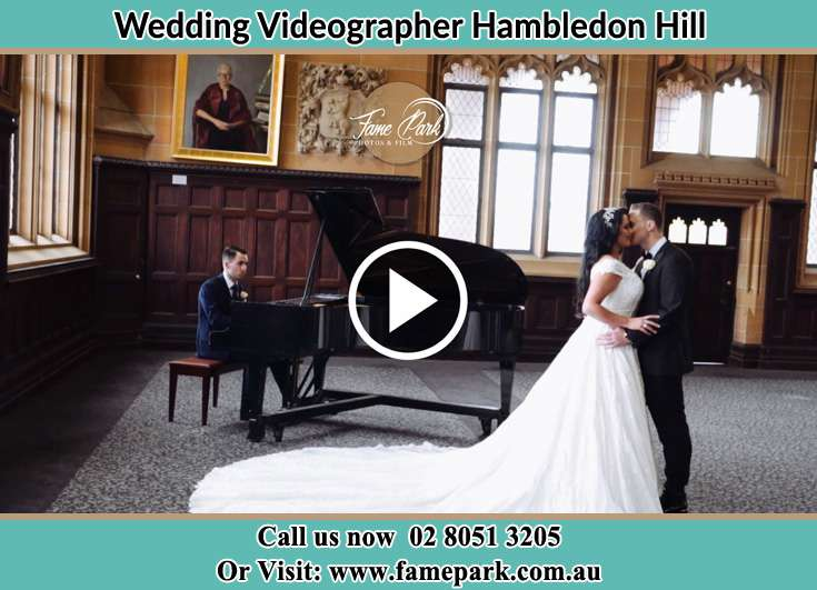 The newlyweds dancing while the pianist playing their song Hambledon Hill NSW 2330