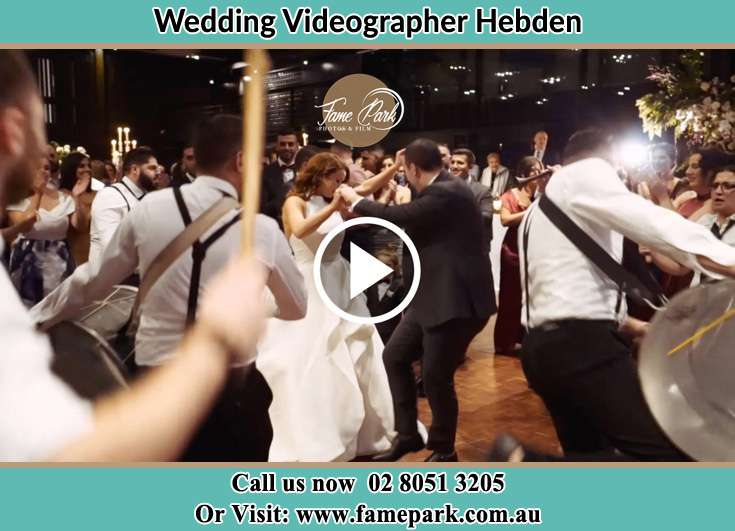 The newlyweds dancing on the dance floor with the band Hebden NSW 2330