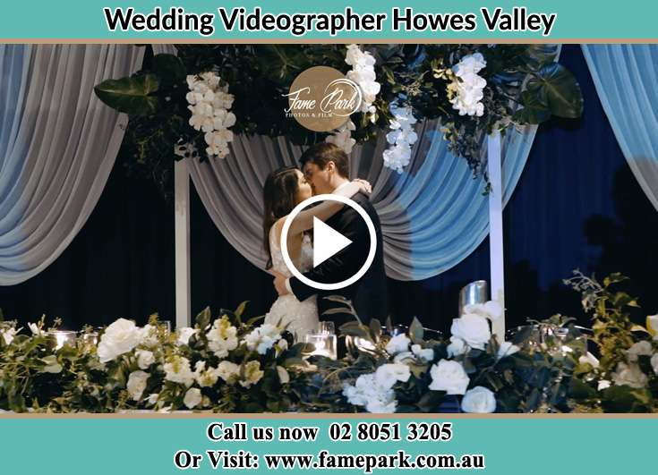 The newlyweds kissing Howes Valley NSW 2330