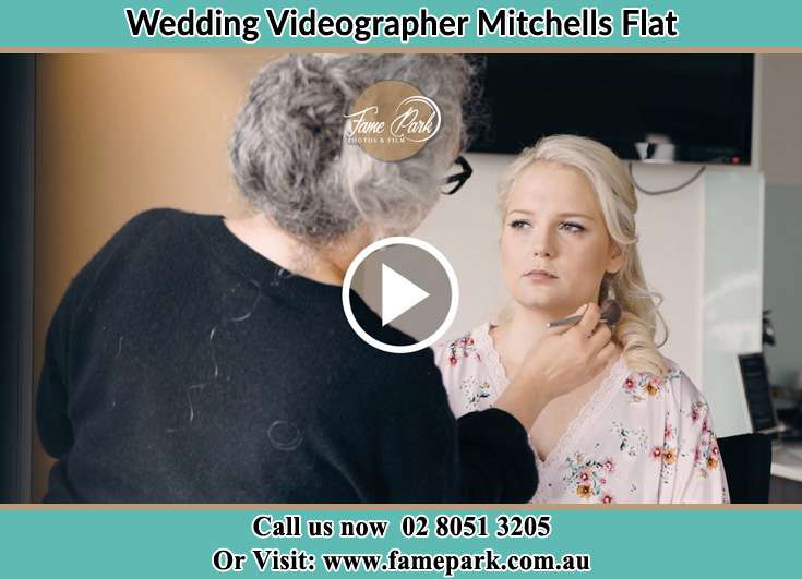 A woman applying makeup to the Bride Mitchells Flat NSW 2330
