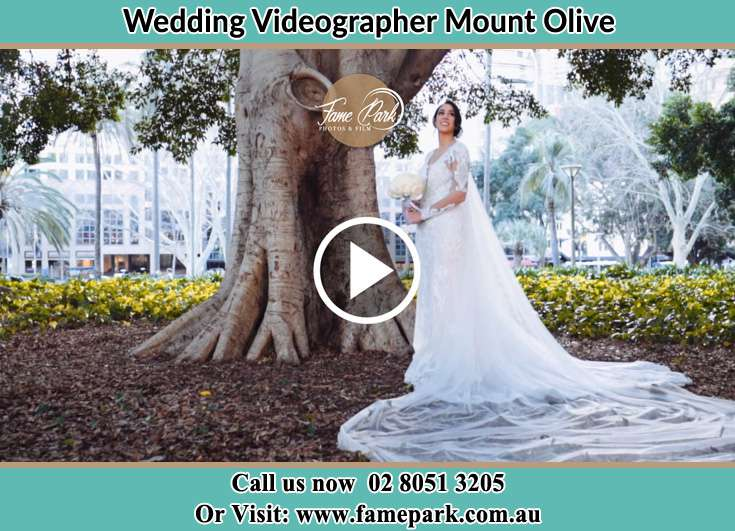 The Bride holding a bouquet of flowers under a tree Mount Olive NSW 2330