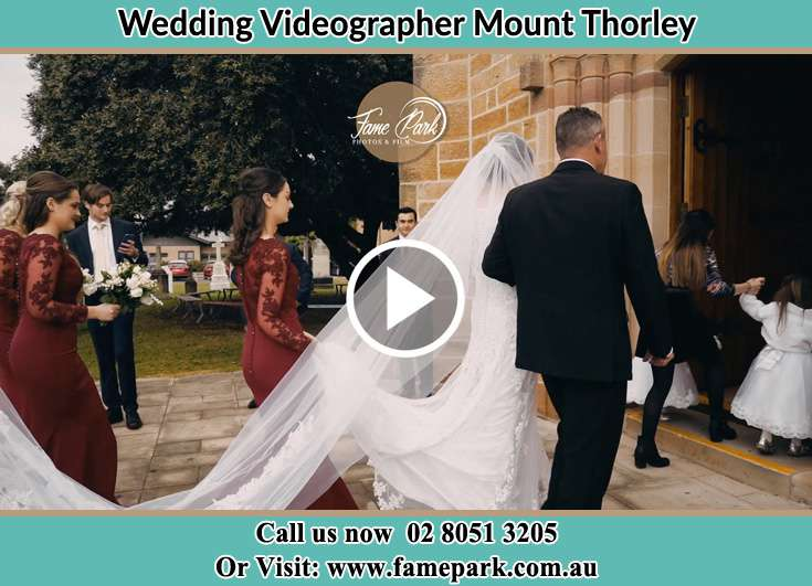 Bride and her father walking through the church entrance Mount Thorley NSW 2330