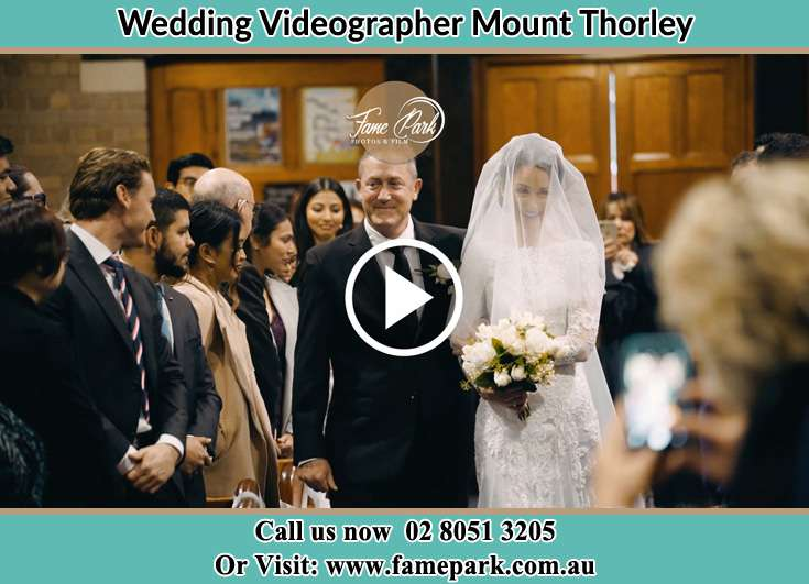 Bride and her father walking in the aisle Mount Thorley NSW 2330