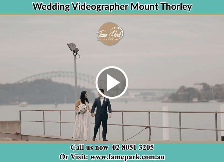 Bride and Groom walking near the shore Mount Thorley NSW 2330
