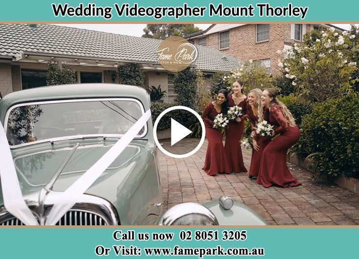 Bride's secondary sponsors looking at the bridal car Mount Thorley NSW 2330