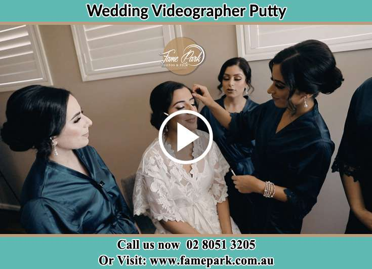 Bride getting her make up done with her secondary sponsors Putty NSW 2330