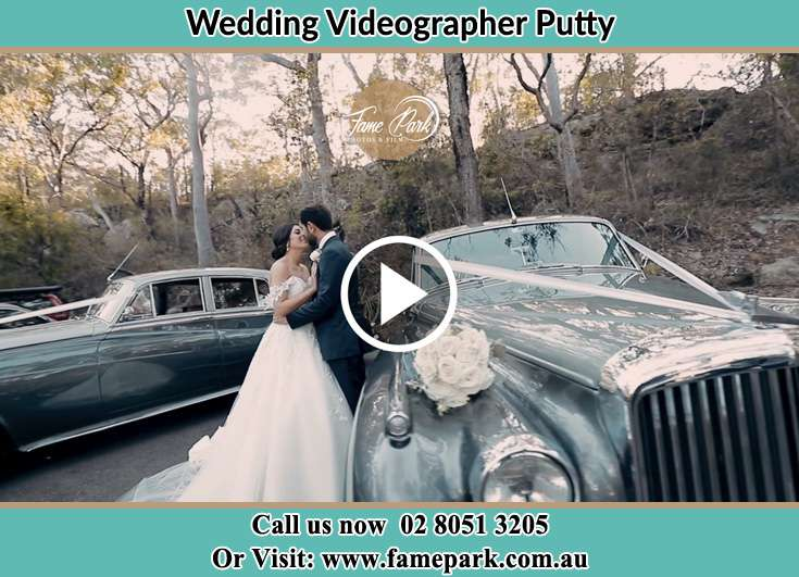 Bride and Groom kissed beside their bridal car Putty NSW 2330