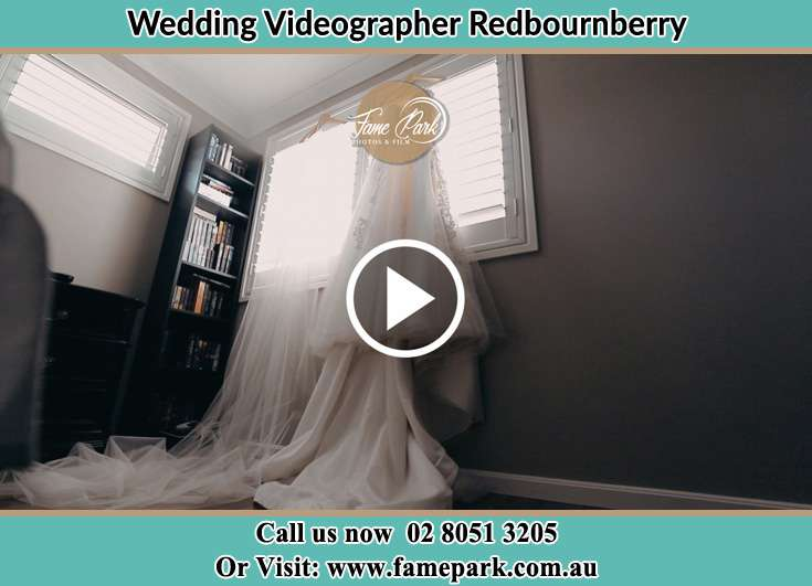 Bride' wedding gown at the window Redbournberry NSW 2330