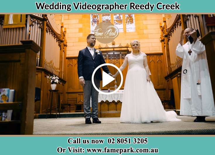 Bride and Groom at the altar with the priest Reedy Creek NSW 2330
