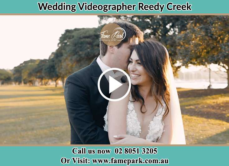 Bride and Groom hold each other at the park Reedy Creek NSW 2330