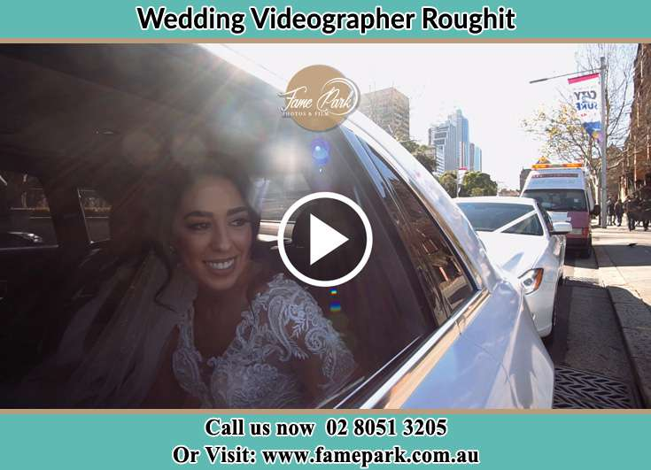 The Bride smiling inside the wedding car Roughit NSW 2330