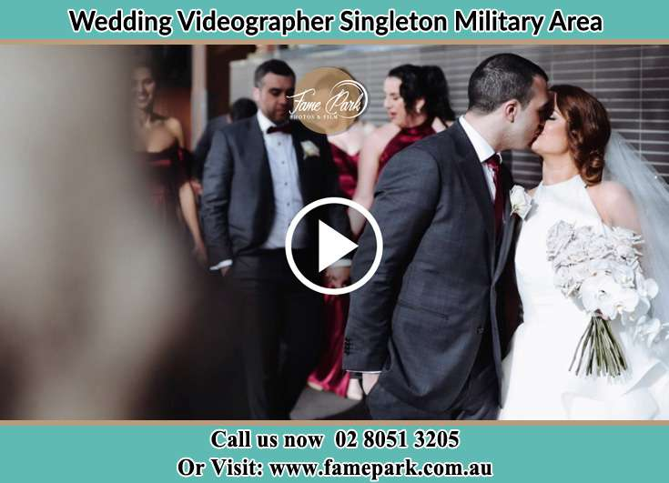 The newlyweds kissing Singleton Military Area NSW 2330